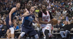 Feb 3, 2016; Dallas, TX, USA; Miami Heat guard Dwyane Wade (3) drives to the basket past Dallas Mavericks guard J.J. Barea (5) during the second half at the American Airlines Center. The Heat defeat the Mavericks 93-90. Mandatory Credit: Jerome Miron-USA TODAY Sports
