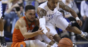 Feb 6, 2016; Lexington, KY, USA; Florida Gators guard Chris Chiozza (11) and Kentucky Wildcats guard Tyler Ulis (3) reach for a loose ball in the first half at Rupp Arena. Mandatory Credit: Mark Zerof-USA TODAY Sports
