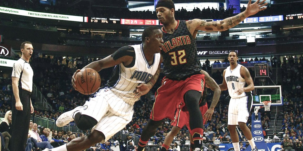 Feb 7, 2016; Orlando, FL, USA;  Atlanta Hawks forward Mike Scott (32) defends against Orlando Magic guard Victor Oladipo (5) during the second half of a basketball game at Amway Center. The Magic won 96-94. Mandatory Credit: Reinhold Matay-USA TODAY Sports