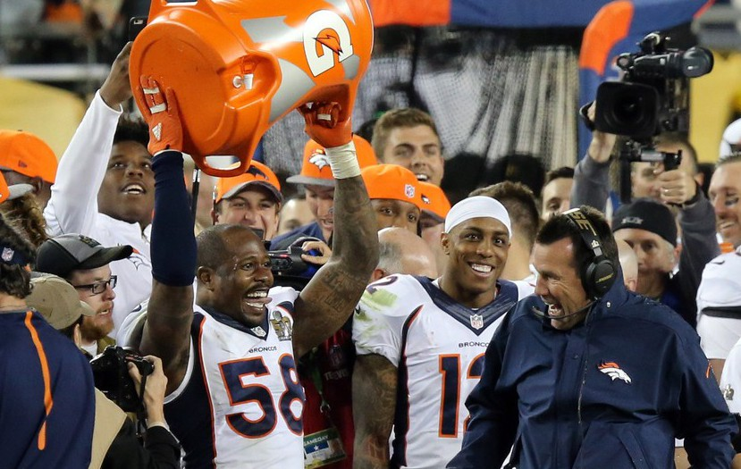 Feb 7, 2016; Santa Clara, CA, USA; Denver Broncos outside linebacker Von Miller (58) reacts after dunking head coach Gary Kubiak after winning Super Bowl 50 against the Carolina Panthers at Levi's Stadium. Mandatory Credit: Kelley L Cox-USA TODAY Sports