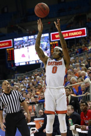 Feb 9, 2016; Gainesville, FL, USA; Florida Gators guard Kasey Hill (0) shoots a three pointer against the Mississippi Rebels during the first half at Stephen C. O'Connell Center. Mandatory Credit: Kim Klement-USA TODAY Sports