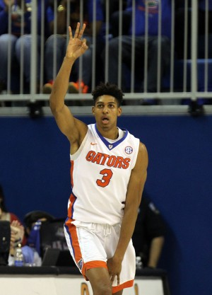 Feb 9, 2016; Gainesville, FL, USA; Florida Gators forward Devin Robinson (3) reacts as he shoots a three pointer against the Mississippi Rebels during the second half at Stephen C. O'Connell Center. Florida Gators defeated the Mississippi Rebels 77-72. Mandatory Credit: Kim Klement-USA TODAY Sports