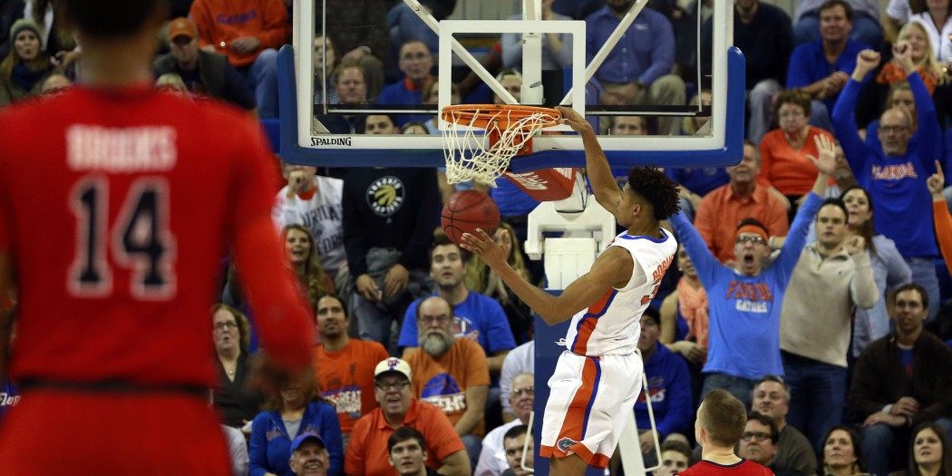 Feb 9, 2016; Gainesville, FL, USA; Florida Gators forward Devin Robinson (3) dunks against the Mississippi Rebels during the second half at Stephen C. O'Connell Center. Florida Gators defeated the Mississippi Rebels 77-72. Mandatory Credit: Kim Klement-USA TODAY Sports