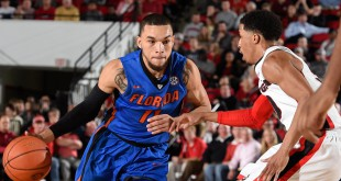 Feb 16, 2016; Athens, GA, USA; Florida Gators guard Chris Chiozza (11) dribbles against Georgia Bulldogs guard J.J. Frazier (30) during the first half at Stegeman Coliseum. Mandatory Credit: Dale Zanine-USA TODAY Sports