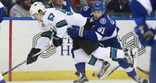 Feb 16, 2016; Tampa, FL, USA; Tampa Bay Lightning center Valtteri Filppula (51) slashes San Jose Sharks center Tommy Wingels (57) during the third period at Amalie Arena. San Jose Sharks defeated the Tampa Bay Lightning 4-2. Mandatory Credit: Kim Klement-USA TODAY Sports