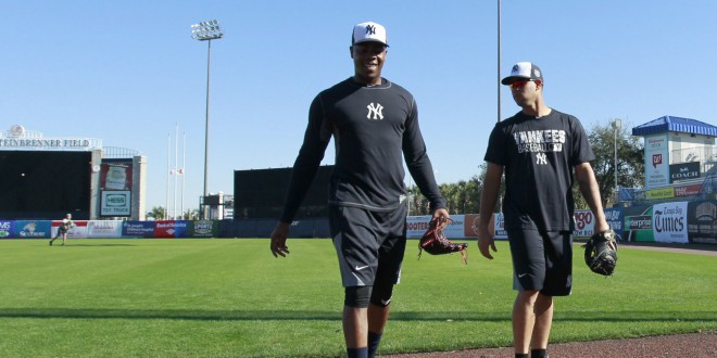 York Yankees Relief Pitcher Aroldis Chapman 54 And New Catcher Gary Sanchez 72 Walk Off The Field As They Practice Or Spring Training At