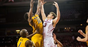 Feb 20, 2016; Fayetteville, AR, USA; Missouri Tigers guard Namon Wright (12) and Arkansas Razorbacks guard Dusty Hannahs (3) go up to rebound the ball in the second half at Bud Walton Arena. The Razorbacks won 84-72. Mandatory Credit: Gunnar Rathbun-USA TODAY Sports