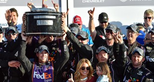 Feb 21, 2016; Daytona Beach, FL, USA; NASCAR Sprint Cup Series driver Denny Hamlin (11) celebrates winning the Daytona 500 at Daytona International Speedway. Mandatory Credit: Jasen Vinlove-USA TODAY Sports