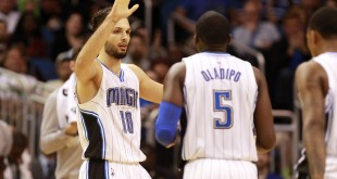Feb 21, 2016; Orlando, FL, USA; Orlando Magic guard Evan Fournier (10), guard Victor Oladipo (5) and teammates high five against the Indiana Pacers during the second half at Amway Center. Indiana Pacers defeated the Orlando Magic 105-102. Mandatory Credit: Kim Klement-USA TODAY Sports
