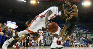 Feb 3, 2016; Gainesville, FL, USA; Florida Gators forward Dorian Finney-Smith (left) dribbles as Arkansas Razorbacks forward Keaton Miles (right) defends in the second half at Stephen C. O'Connell Center. The Florida Gators won 87-83. Mandatory Credit: Logan Bowles-USA TODAY Sports