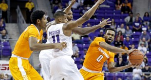 Jan 30, 2016; Fort Worth, TX, USA; Tennessee Volunteers guard Kevin Punter (0) looks to pass around TCU Horned Frogs guard Brandon Parrish (11) during the second half at Ed and Rae Schollmaier Arena. Mandatory Credit: Kevin Jairaj-USA TODAY Sports