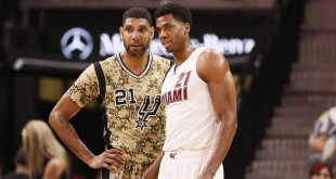 Mar 23, 2016; San Antonio, TX, USA; San Antonio Spurs power forward Tim Duncan (21) and Miami Heat center Hassan Whiteside (21) talk during the first half at AT&T Center. Mandatory Credit: Soobum Im-USA TODAY Sports