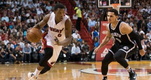 Mar 28, 2016; Miami, FL, USA; Miami Heat guard Josh Richardson (0) dribbles the ball past Brooklyn Nets guard Shane Larkin (0) during the second half at American Airlines Arena. The Heat won 110-99. Mandatory Credit: Steve Mitchell-USA TODAY Sports