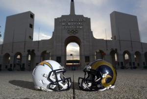 Mar 4, 2016; Los Angeles, CA, USA; General view of Los Angeles Rams and San Diego Chargers helmets and the Olympic torch at the peristyle end of the Los Angeles Memorial Coliseum. The Coliseum will serve as the temporary home of the Rams after NFL owners voted 30-2 to allow Rams owner Stan Kroenke (not pictured) to relocate the franchise for the 2016 season. Chargers owner Dean Spanos (not pictured) has an option to join the Rams in Los Angeles. Mandatory Credit: Kirby Lee-USA TODAY Sports