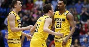 Mar 16, 2016; Dayton, OH, USA; Michigan Wolverines guard Zak Irvin (21) reacts with teammates during the second half against the Tulsa Golden Hurricane in the First Four of the NCAA men's college basketball tournament at Dayton Arena. Michigan won 67-62. Mandatory Credit: Rick Osentoski-USA TODAY Sports
