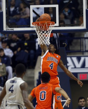 Dec 19, 2015; Cincinnati, OH, USA; Auburn Tigers guard T.J. Dunans (4) dunks during the first half against the Xavier Musketeers at the Cintas Center. Xavier won 85-61. Mandatory Credit: Frank Victores-USA TODAY Sports
