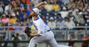 Jun 13, 2015; Omaha, NE, USA;  Florida Gators pitcher Logan Shore (32) started the game against the Miami Hurricanes in the 2015 College World Series at TD Ameritrade Park. Mandatory Credit: Steven Branscombe-USA TODAY Sports