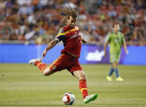 Aug 22, 2015; Sandy, UT, USA; Real Salt Lake midfielder Kyle Beckerman (5) shoots the ball against the Seattle Sounders FC in the first half at Rio Tinto Stadium. Mandatory Credit: Jeff Swinger-USA TODAY Sports