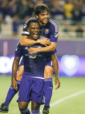 Oct 3, 2015; Orlando, FL, USA; Orlando City FC midfielder Kaka (10) and forward Cyle Larin (21) celebrate a goal against the Montreal Impact during the first half of an MLS Soccer match at Orlando Citrus Bowl Stadium. Mandatory Credit: Reinhold Matay-USA TODAY Sports