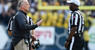 Nov 28, 2015; Atlanta, GA, USA; Georgia Bulldogs head coach Mark Richt talks to the game referee during the game against the Georgia Tech Yellow Jackets during the second half at Bobby Dodd Stadium. Georgia defeated Georgia Tech 13-7. Mandatory Credit: Dale Zanine-USA TODAY Sports
