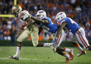 Nov 28, 2015; Gainesville, FL, USA; Florida State Seminoles running back Dalvin Cook (4) runs past Florida Gators defensive back Marcus Maye (20) during the second half at Ben Hill Griffin Stadium. Florida State defeated Florida 27-2. Mandatory Credit: Kim Klement-USA TODAY Sports