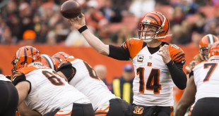 Dec 6, 2015; Cleveland, OH, USA; Cincinnati Bengals quarterback Andy Dalton (14) throws a pass during the third quarter against the Cleveland Browns at FirstEnergy Stadium. The Bengals defeated the Browns 37-3. Mandatory Credit: Scott R. Galvin-USA TODAY Sports