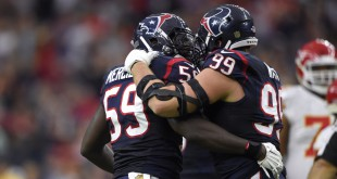 Jan 9, 2016; Houston, TX, USA; Houston Texans outside linebacker Whitney Mercilus (59) reacts with defensive end J.J. Watt (99) after sacking Kansas City Chiefs quarterback Alex Smith (not pictured) during the second quarter in a AFC Wild Card playoff football game at NRG Stadium. Mandatory Credit: John David Mercer-USA TODAY Sports