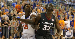 Feb 3, 2016; Gainesville, FL, USA; Arkansas Razorbacks forward Moses Kingsley (33) defends Florida Gators center John Egbunu (15) in the first half at Stephen C. O'Connell Center. Mandatory Credit: Logan Bowles-USA TODAY Sports