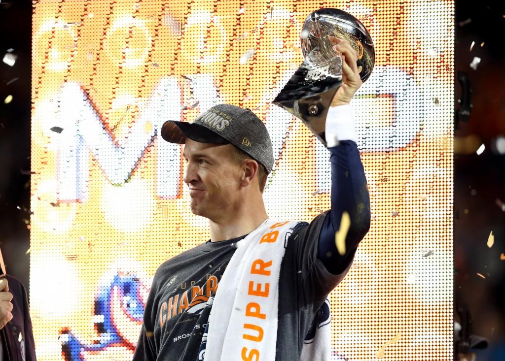 Feb 7, 2016; Santa Clara, CA, USA; Denver Broncos quarterback Peyton Manning (18) hoists the Vince Lombardi Trophy after beat the Carolina Panthers in Super Bowl 50 at Levi's Stadium. Mandatory Credit: Matthew Emmons-USA TODAY Sports