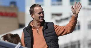 Feb 9, 2016; Denver, CO, USA; Denver Broncos quarterback Peyton Manning waves to the crowd during the Super Bowl 50 championship parade at Civic Center Park. Mandatory Credit: Ron Chenoy-USA TODAY Sports