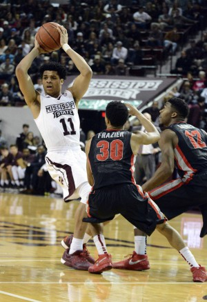 Feb 13, 2016; Starkville, MS, USA; Mississippi State Bulldogs guard Quinndary Weatherspoon (11) is guarded by Georgia Bulldogs guard J.J. Frazier (30) and guard Kenny Gaines (12) during the first half of the game at Humphrey Coliseum. Mandatory Credit: Matt Bush-USA TODAY Sports
