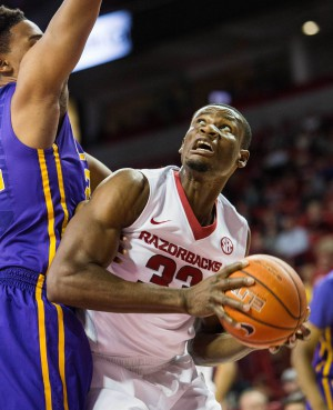 Feb 23, 2016; Fayetteville, AR, USA; Arkansas Razorbacks forward Moses Kingsley (33) looks to the basket while being guarded by LSU Tigers forward Craig Victor II (32) in the first half at Bud Walton Arena. Mandatory Credit: Gunnar Rathbun-USA TODAY Sports