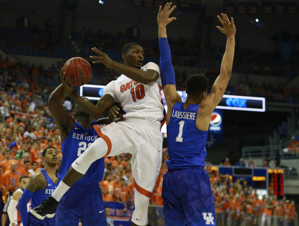 Mar 1, 2016; Gainesville, FL, USA; Florida Gators forward Dorian Finney-Smith (10) passes the ball around Kentucky Wildcats forward Skal Labissiere (1) during the first half at Stephen C. O'Connell Center. Mandatory Credit: Kim Klement-USA TODAY Sports
