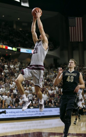 Mar 5, 2016; College Station, TX, USA; Texas A&M Aggies guard Alex Caruso (21) goes up for a slam dunk against Vanderbilt Commodores center Josh Henderson (40) at Reed Arena. A&M won 76-67 and the SEC Championship with the victory. Mandatory Credit: Erich Schlegel-USA TODAY Sports