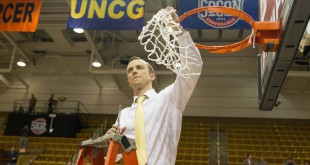 Mar 7, 2016; Asheville, NC, USA; Chattanooga Mocs head coach Matt McCall holds up the net after defeating the East Tennessee State Buccaneers in the Southern Conference tournament final at the U.S. Cellular Center.  Chattanooga defeated East Tennessee State 73-67. Mandatory Credit: Jeremy Brevard-USA TODAY Sports
