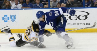Mar 8, 2016; Tampa, FL, USA; Tampa Bay Lightning defenseman Nikita Nesterov (89) defends Boston Bruins left wing David Pastrnak (88) during the third period at Amalie Arena. Mandatory Credit: Kim Klement-USA TODAY Sports