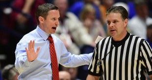Mar 11, 2016; Nashville, TN, USA; Florida Gators head coach Mike White questions a call against the Texas A&M Aggies during the SEC conference tournament at Bridgestone Arena. Texas A&M Aggies won 72-66. Mandatory Credit: Christopher Hanewinckel-USA TODAY Sports