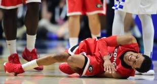 Mar 12, 2016; Nashville, TN, USA; Georgia Bulldogs guard J.J. Frazier (30) suffers an injury in the second half against the Kentucky Wildcats during the SEC conference tournament at Bridgestone Arena. Kentucky won 93-80. Mandatory Credit: Christopher Hanewinckel-USA TODAY Sports