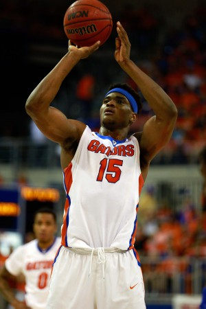 Mar 1, 2016; Gainesville, FL, USA; Florida Gators center John Egbunu (15) shoots a free throw against the Kentucky Wildcats during the first half at Stephen C. O'Connell Center. Mandatory Credit: Kim Klement-USA TODAY Sports
