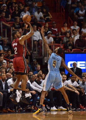 Mar 14, 2016; Miami, FL, USA; Miami Heat forward Joe Johnson (2) makes a three point basket over Denver Nuggets forward Will Barton (5) during the first half at American Airlines Arena. Mandatory Credit: Steve Mitchell-USA TODAY Sports
