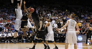 Mar 15, 2016; Dayton, OH, USA; Wichita State Shockers forward Rashard Kelly (0) shoots while guarded by Vanderbilt Commodores forward Luke Kornet (3) during the second half of the First Four of the NCAA men's college basketball tournament at Dayton Arena. Wichita State won 70-50. Mandatory Credit: Rick Osentoski-USA TODAY Sports