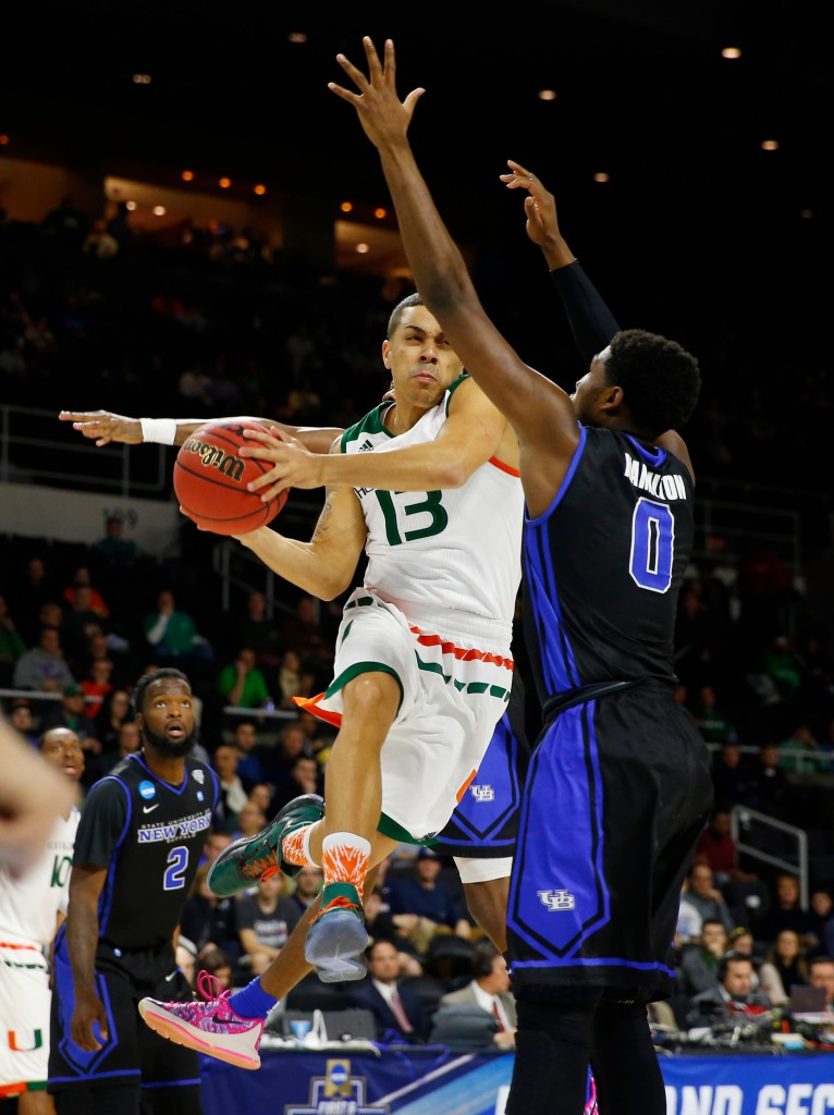 Mar 17, 2016; Providence, RI, USA; Miami Hurricanes guard Angel Rodriguez (13) drives against Buffalo Bulls guard Blake Hamilton (0) during the first half of a first round game of the 2016 NCAA Tournament at Dunkin Donuts Center. Mandatory Credit: Winslow Townson-USA TODAY Sports
