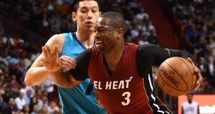 Mar 17, 2016; Miami, FL, USA; Miami Heat guard Dwyane Wade (3) is fouled by Charlotte Hornets guard Jeremy Lin (7) during the second half at American Airlines Arena. Mandatory Credit: Steve Mitchell-USA TODAY Sports