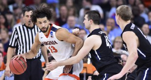 Mar 19, 2016; Raleigh, NC, USA; Virginia Cavaliers forward Anthony Gill (13) dribbles the ball as Butler Bulldogs forward Andrew Chrabascz (45) and forward Austin Etherington (0) defend in the second half during the second round of the 2016 NCAA Tournament at PNC Arena. The Cavaliers won 77-69. Mandatory Credit: Bob Donnan-USA TODAY Sports