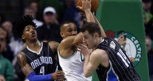 Mar 21, 2016; Boston, MA, USA; Boston Celtics guard Avery Bradley (0) pulls down a rebound while guarded by Orlando Magic point guard Elfrid Payton (4) and forward Jason Smith (14) during the fourth quarter at TD Garden.  The Boston Celtics won 107-96.  Mandatory Credit: Greg M. Cooper-USA TODAY Sports