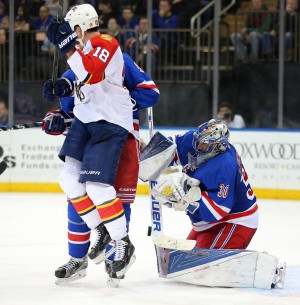 Mar 21, 2016; New York, NY, USA; New York Rangers goalie Henrik Lundqvist (30) makes a save in front of Florida Panthers right wing Reilly Smith (18) during the third period at Madison Square Garden. The Rangers defeated the Panthers 4-2. Mandatory Credit: Brad Penner-USA TODAY Sports