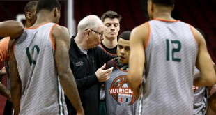 Miami Hurricanes head coach Jim Larranaga talks to guard Angel Rodriguez (13) during practice the day before the semifinals of the South regional of the NCAA Tournament at KFC YUM!.