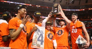 Mar 27, 2016; Chicago, IL, USA; Syracuse Orange players celebrate with the trophy after defeating the Virginia Cavaliers in the championship game of the midwest regional of the NCAA Tournament at the United Center. Mandatory Credit: Dennis Wierzbicki-USA TODAY Sports