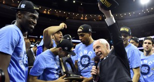 Mar 27, 2016; Philadelphia, PA, USA; North Carolina Tar Heels head coach Roy Williams celebrates with his team after defeating Notre Dame Fighting Irish in the championship game in the East regional of the NCAA Tournament at Wells Fargo Center. Carolina won 88-74. Mandatory Credit: Bob Donnan-USA TODAY Sports