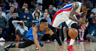 Mar 29, 2016; Auburn Hills, MI, USA; Oklahoma City Thunder guard Russell Westbrook (0) and Detroit Pistons guard Kentavious Caldwell-Pope (5) battle for the ball during the third quarter at The Palace of Auburn Hills. Mandatory Credit: Tim Fuller-USA TODAY Sports